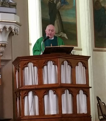 Fr. Brian Harrison delivers the homily at Mass.